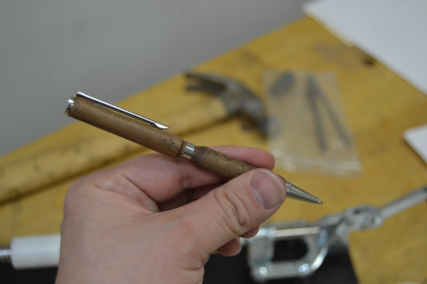 Holding a fresh pen.